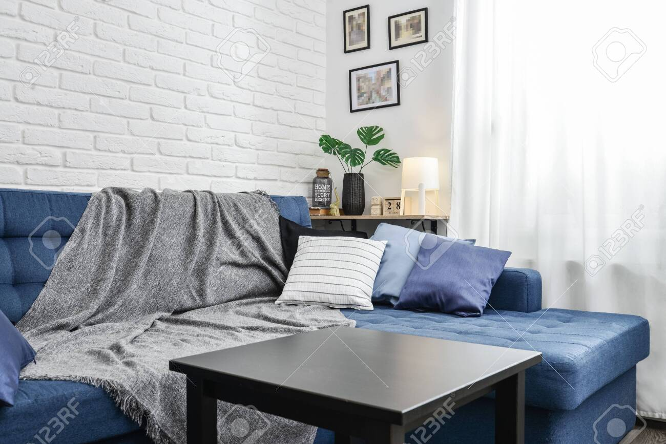 Image of: Bright Living Room In Scandinavian Style With Blue Couch Decorative Stock Photo Picture And Royalty Free Image Image 133224793