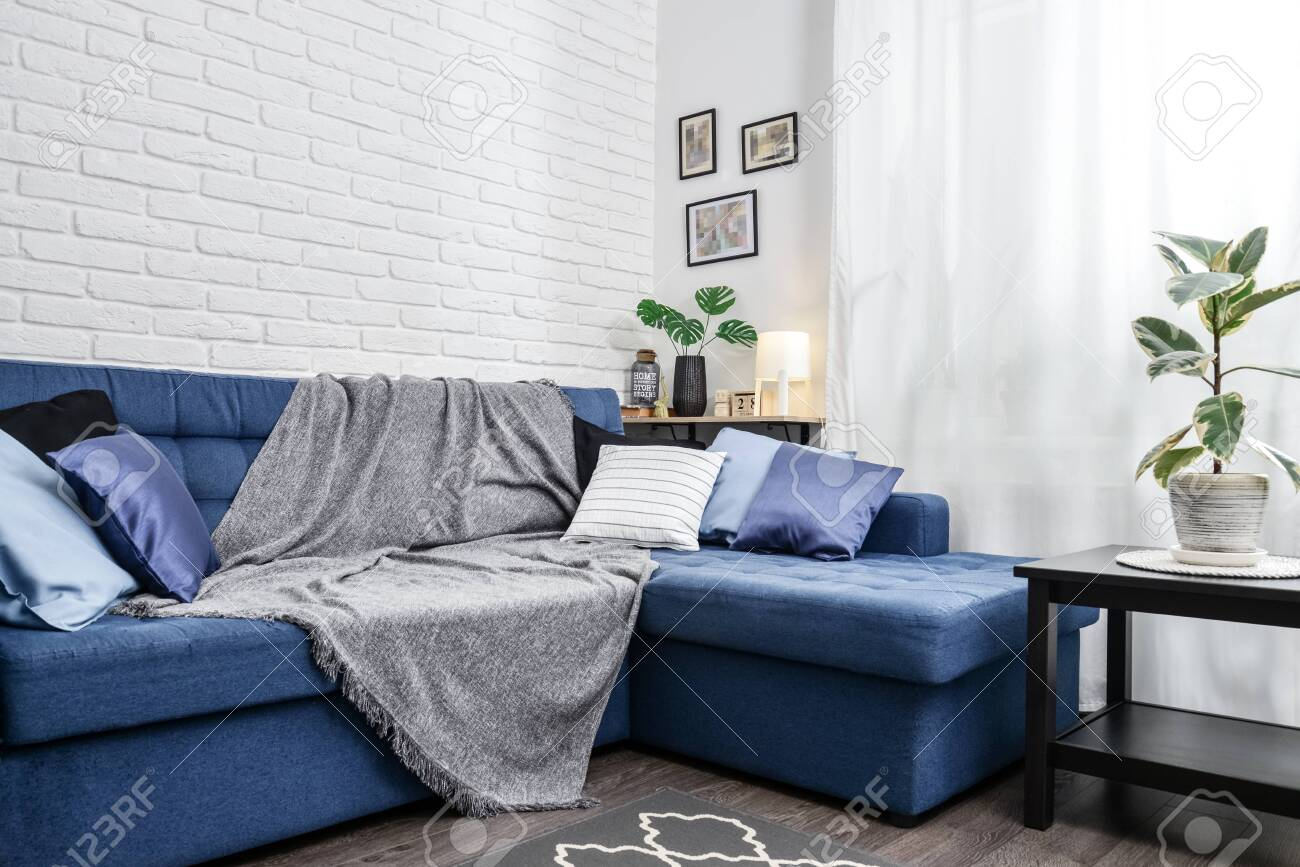 Image of: Bright Living Room In Scandinavian Style With Blue Couch Decorative Stock Photo Picture And Royalty Free Image Image 133232233