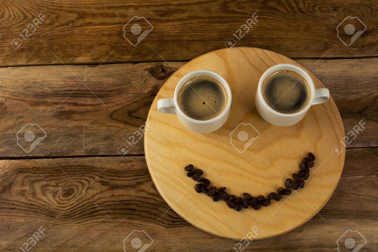 Funny coffee break concept on wooden background. Coffee cup. Coffee mug. Morning coffee