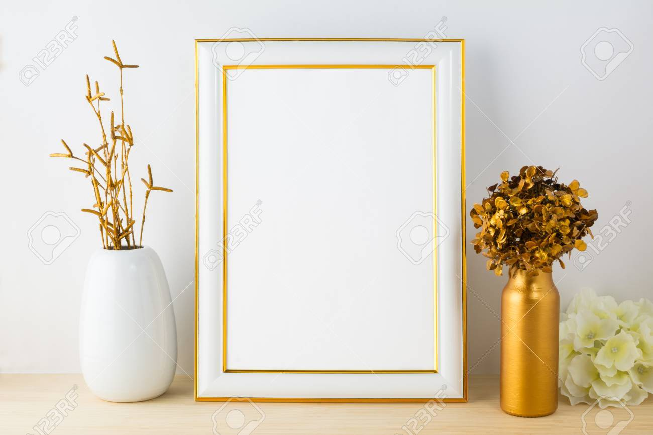 08429f069902 Stock Photo - White frame mockup with white and golden vases. Portrait or  poster white frame mockup. Empty white frame mockup for design presentation.