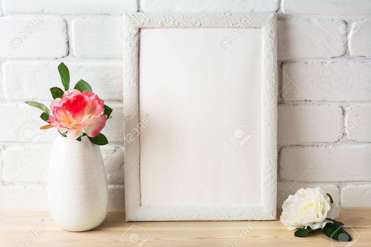 524ffac37ec9 Stock Photo - White frame mockup with pink and white roses. Portrait or  poster white frame mockup. Empty white frame mockup for design presentation.