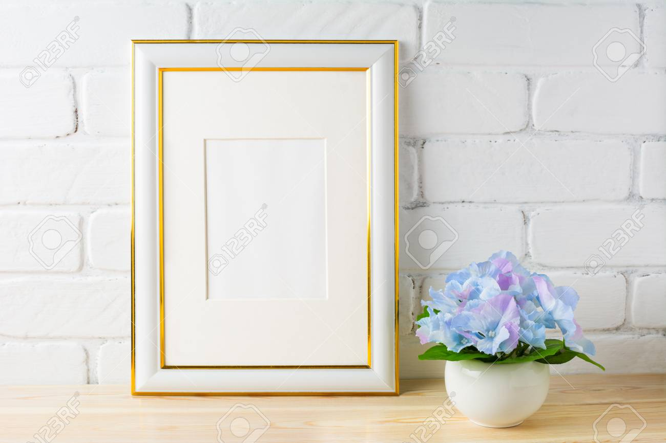 f7da50af27dd Stock Photo - White frame mockup with blue hydrangea. Empty white frame  mockup for design presentation. Portrait or poster white frame mockup for  artwork ...