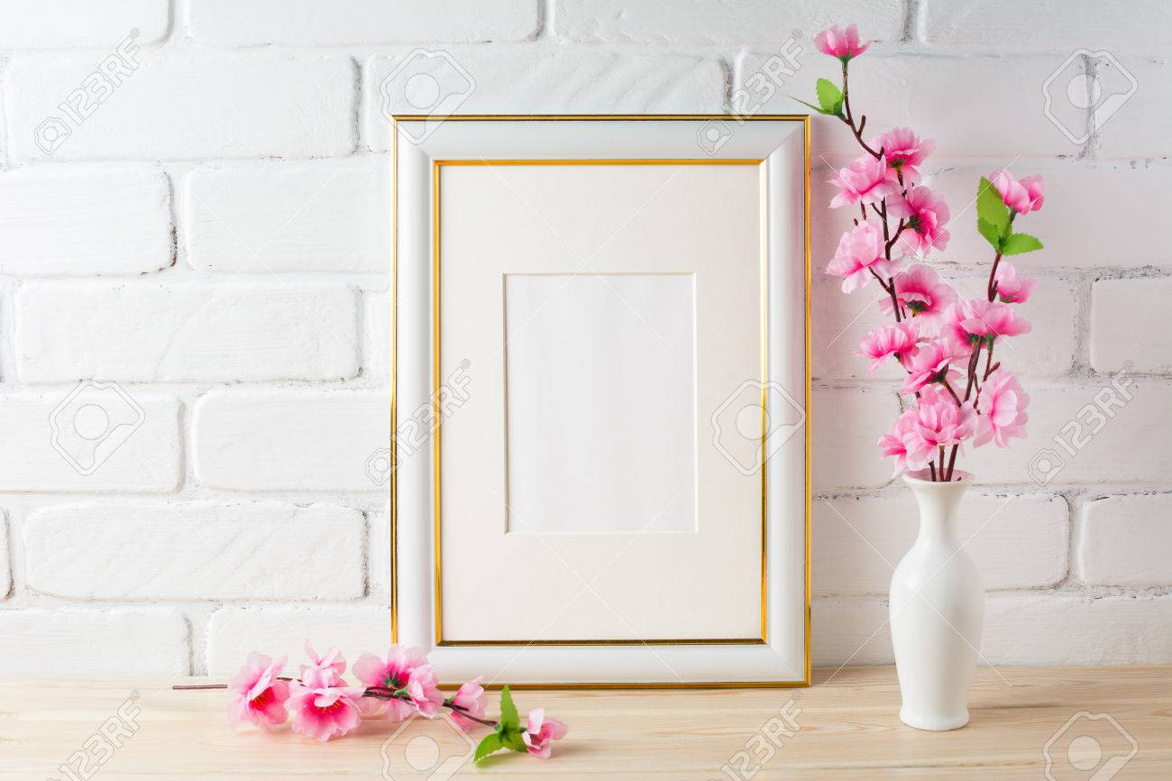 9520c3d42645 Stock Photo - White frame mockup with pink flower bunch. Empty white frame  mockup for design presentation. Portrait or poster white frame mockup  romantic ...