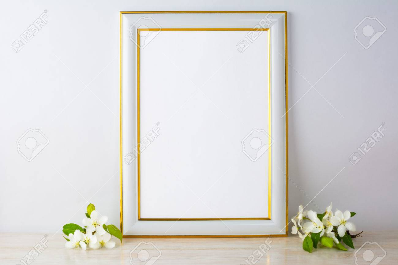 6ab67e3a61c7 Stock Photo - White frame mockup with apple blossom. Empty white frame  mockup for design presentation. Portrait or poster white frame mockup  romantic style.