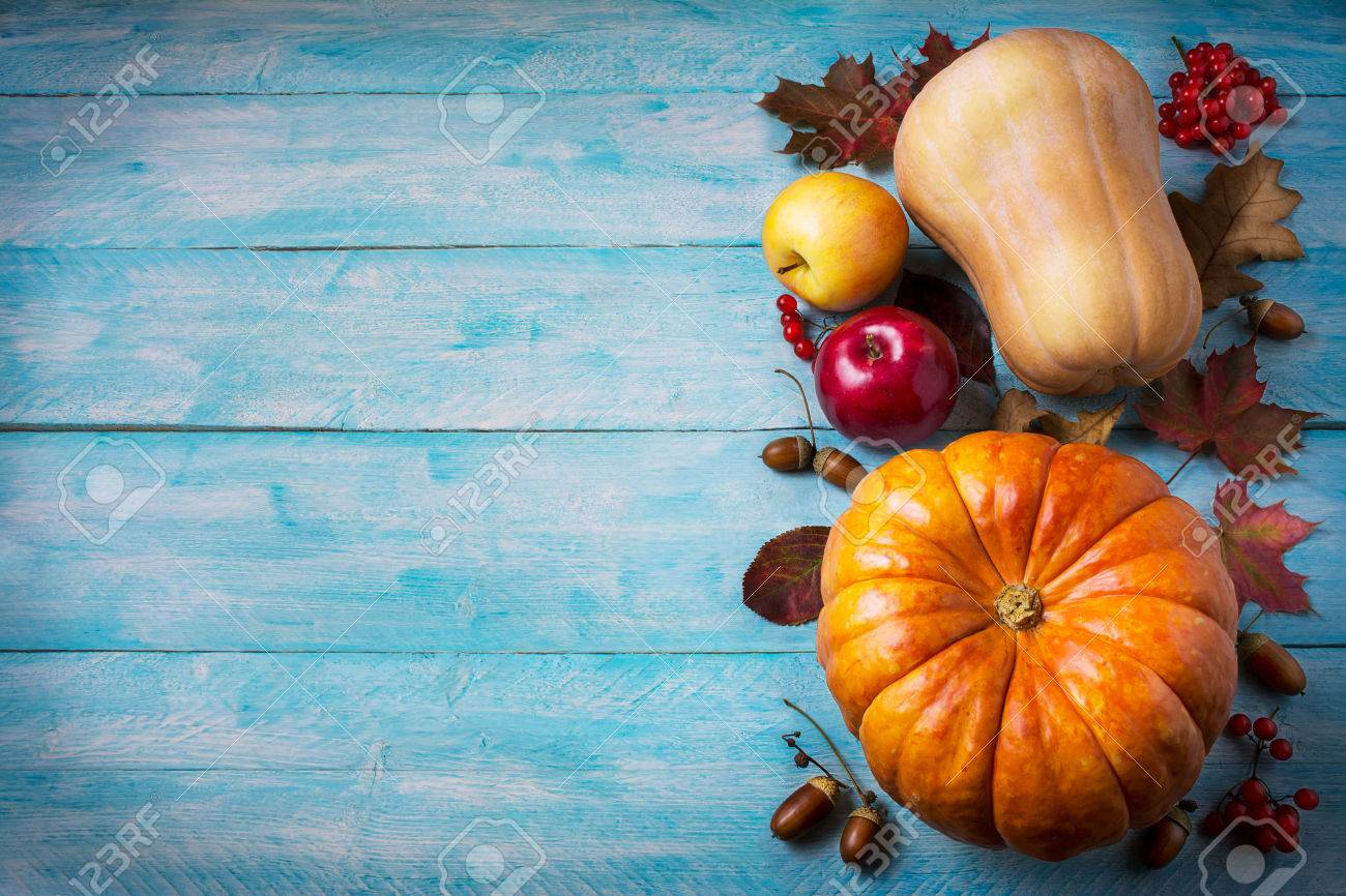 Thanksgiving Greeting With Pumpkins And Fall Leaves On Blue Stock
