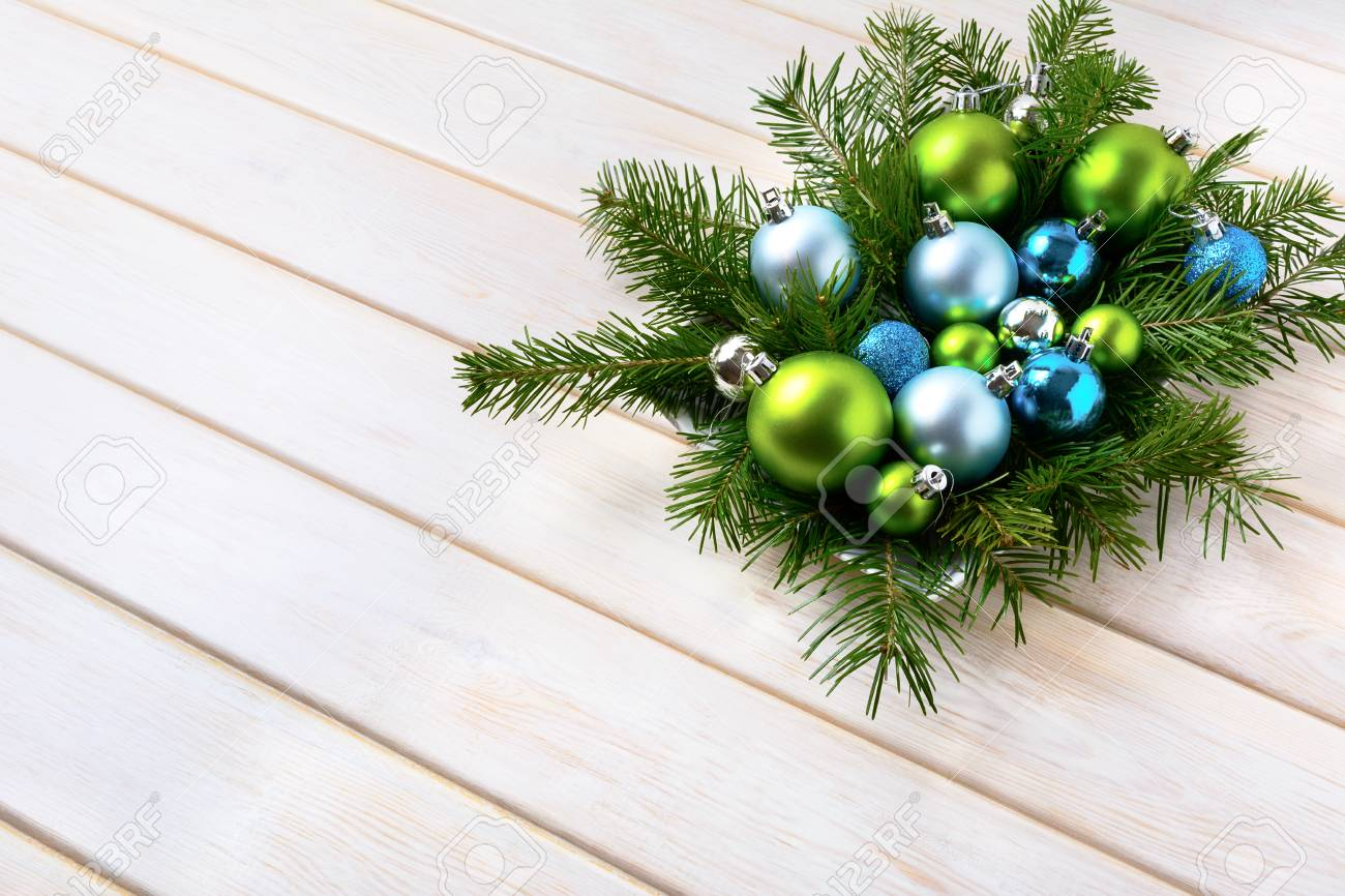 Christmas Dinner Table Centerpiece With Navy Blue And Green Ornaments
