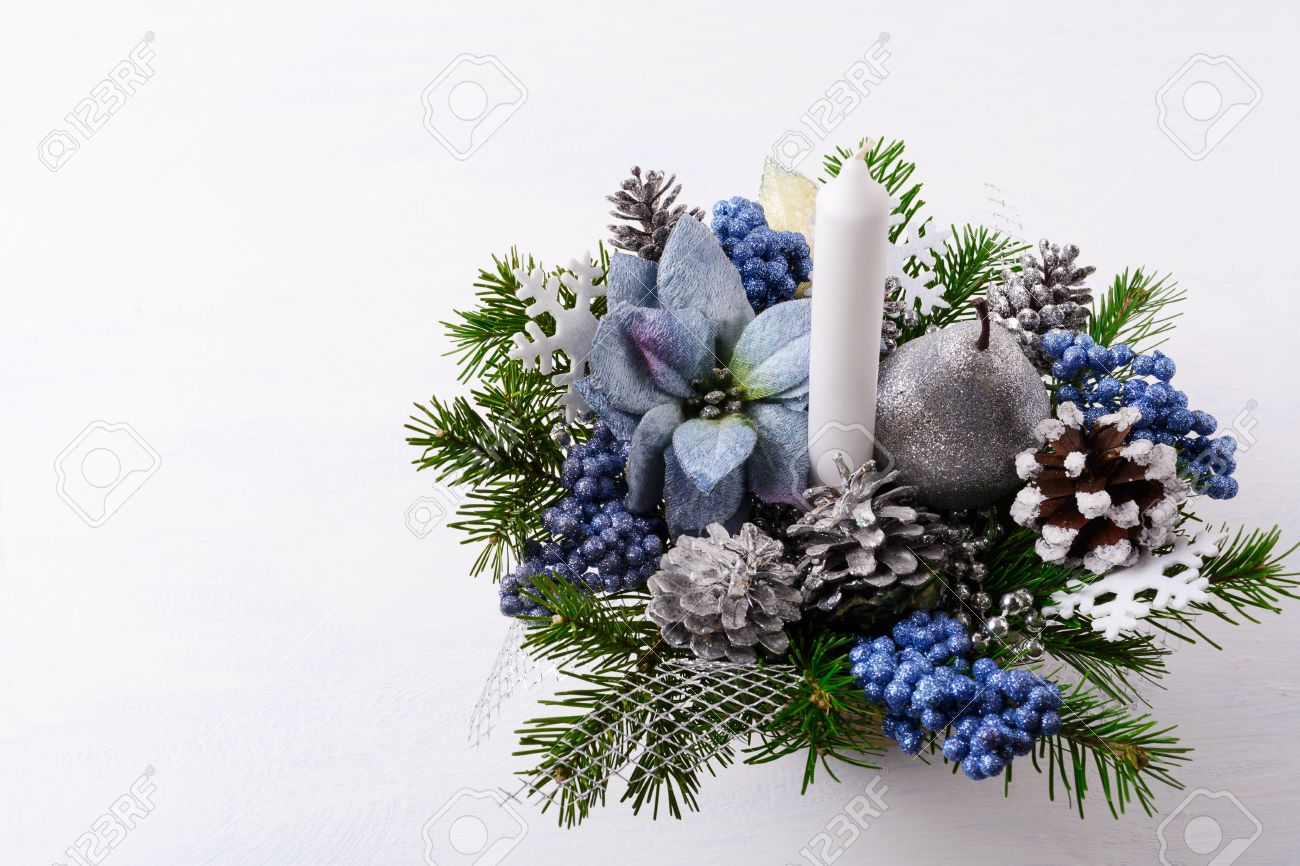Christmas Flower Arrangements Artificial.Christmas Background With Candle And Blue Silk Poinsettias Artificial