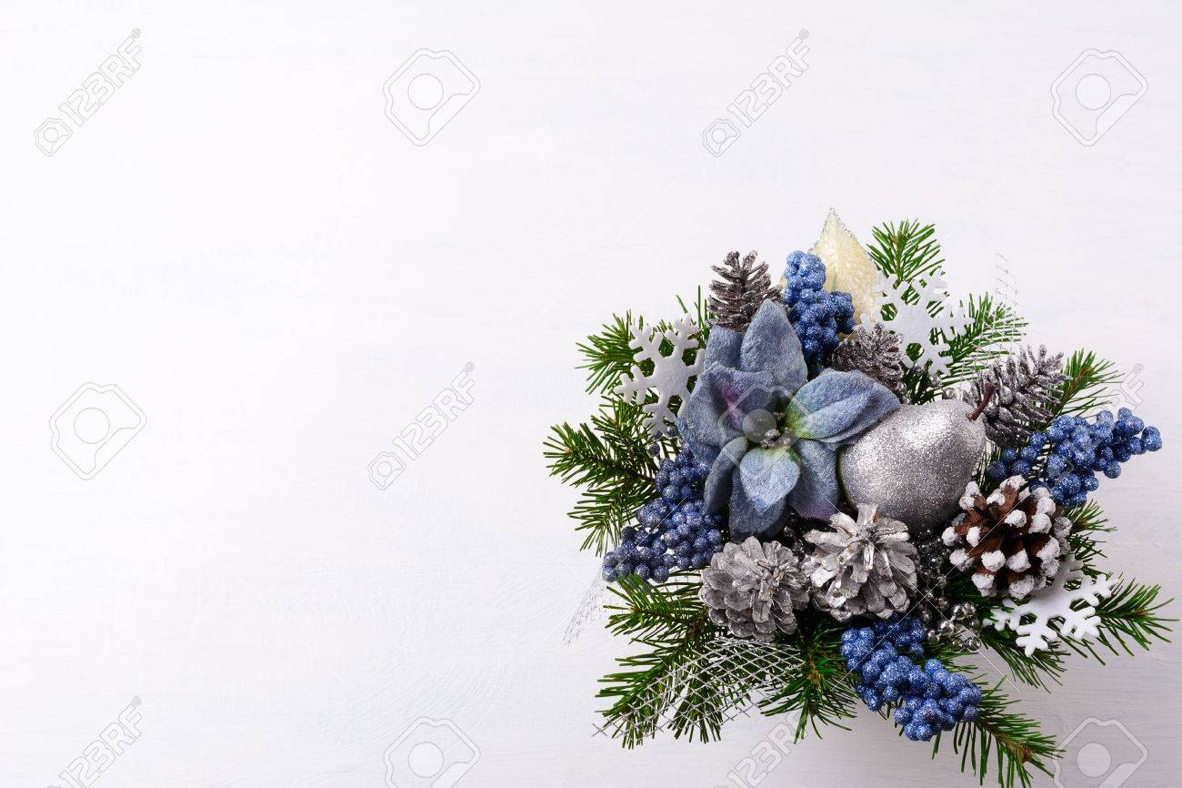 Christmas background with silver glitter decor and blue silk christmas background with silver glitter decor and blue silk poinsettias artificial christmas flower arrangement with mightylinksfo