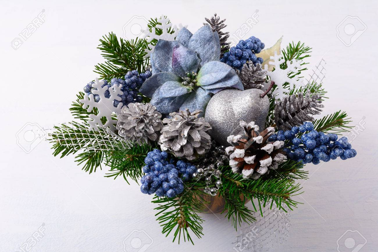 Christmas Table Arrangements Flowers.Christmas Greenery With Silver Glitter Decor And Blue Silk Poinsettias
