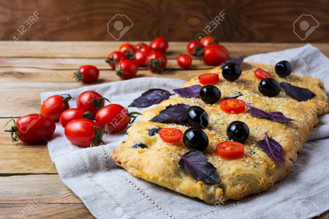 Focaccia With Olive Cherry Tomato And Basil Leaves Homemade Stock Photo Picture And Royalty Free Image Image 71127770