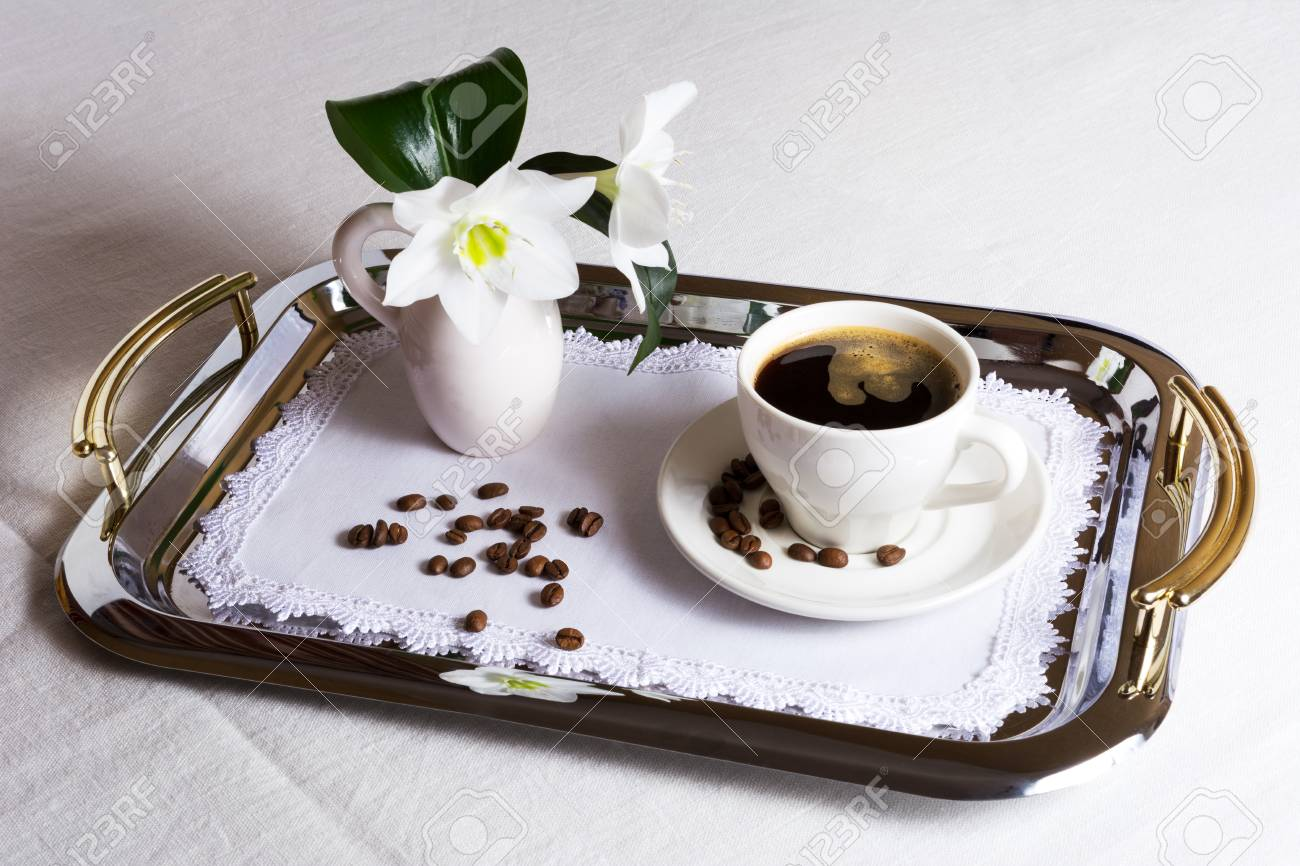 Cup Of Coffee On Exquisite Embroidered Napkin On Silver Serving Stock Photo Picture And Royalty Free Image Image 74864750