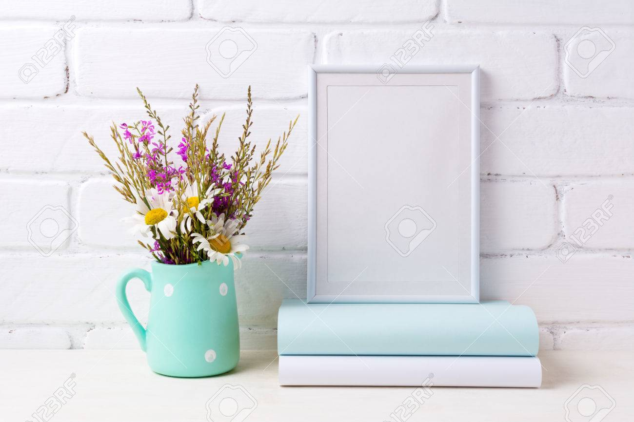 White frame mockup with white chamomile and purple field flowers white frame mockup with white chamomile and purple field flowers in mint green pitcher vase and reviewsmspy