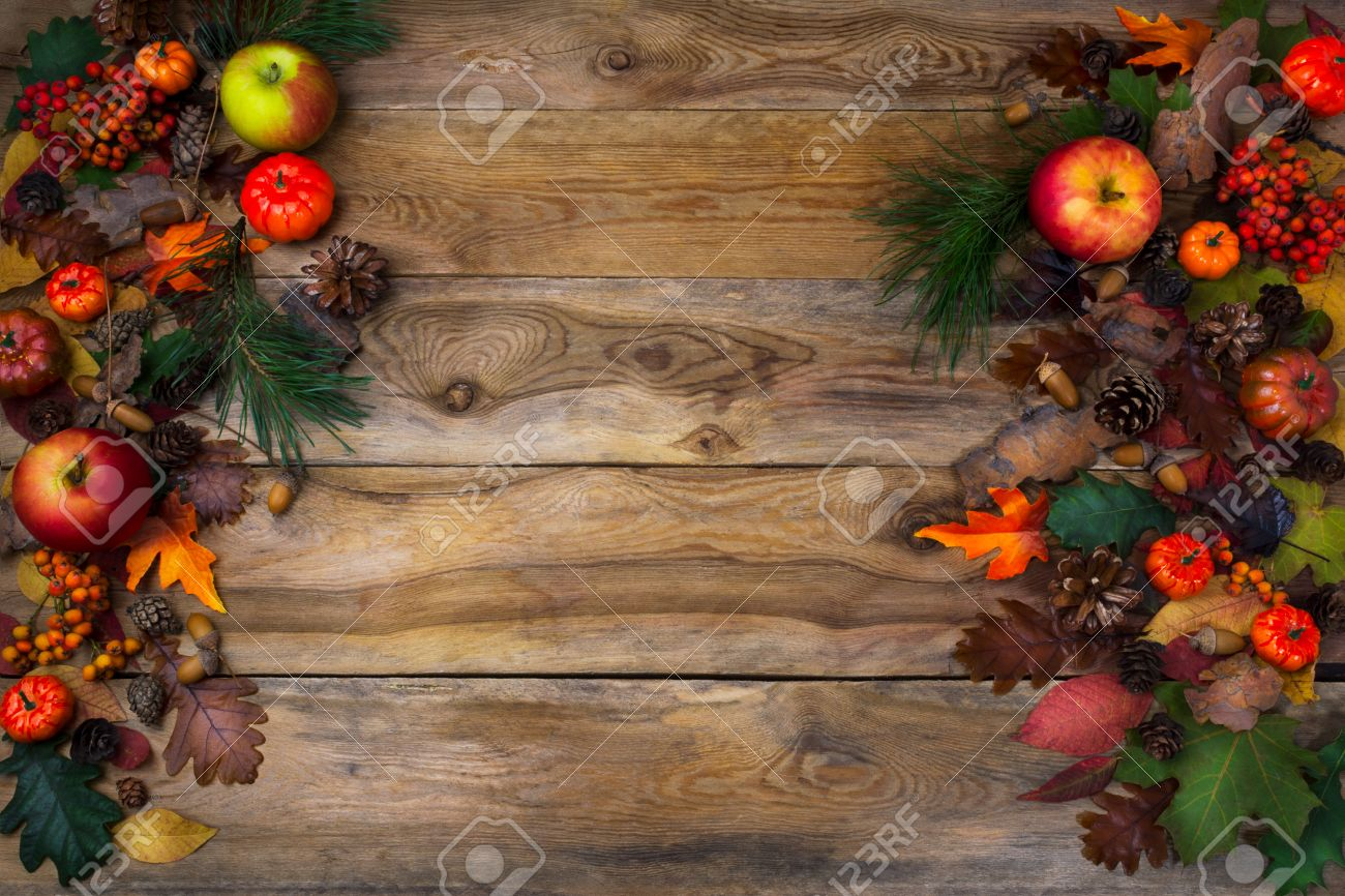 Rustic Thanksgiving Decoration With Pumpkin Apples And Cones On Wooden Table Fall Background