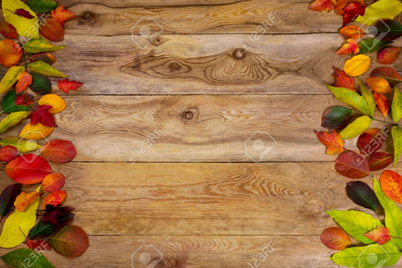 Happy Thanksgiving Greeting With Frame Of Colorful Autumn Leaves On The Rustic Wooden Table Fall
