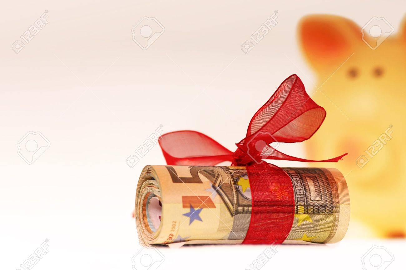 bankroll of euros with piggy bank background Stock Photo - 4081787