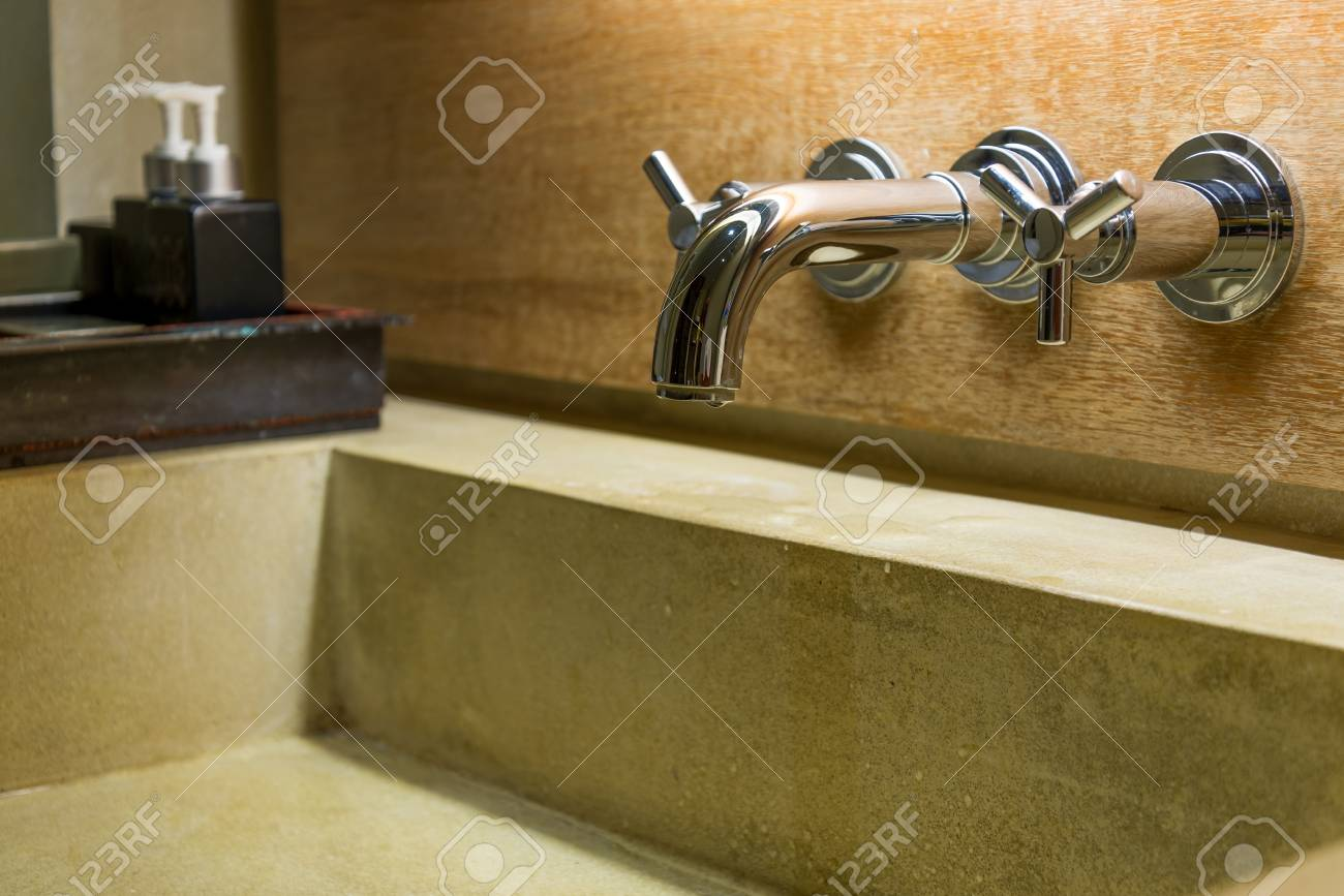 Hot Cold Separated Shiny Metal Water Tap In Bathroom Stock Photo ...