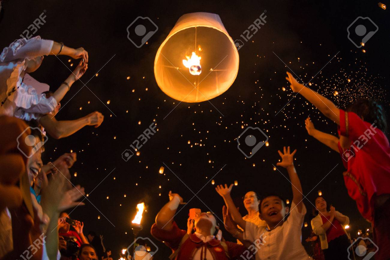 CHIANGMAI - November 16 Unidentified People launch sky lanterns to the sky in Loy Kratong festival on November 16,2013 in Chiangmai,Thailand - 24047967