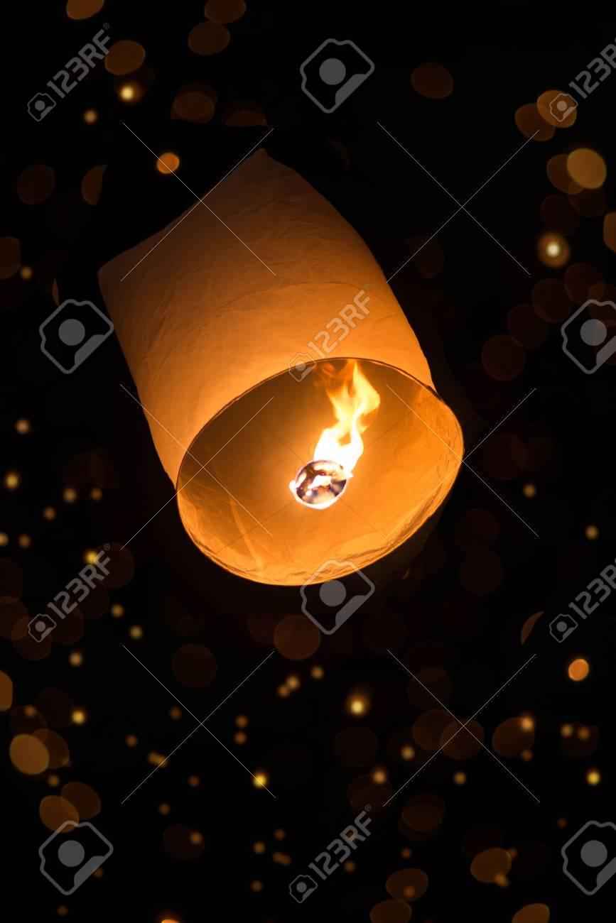 sky lantern with bokeh in the dark - 24063789