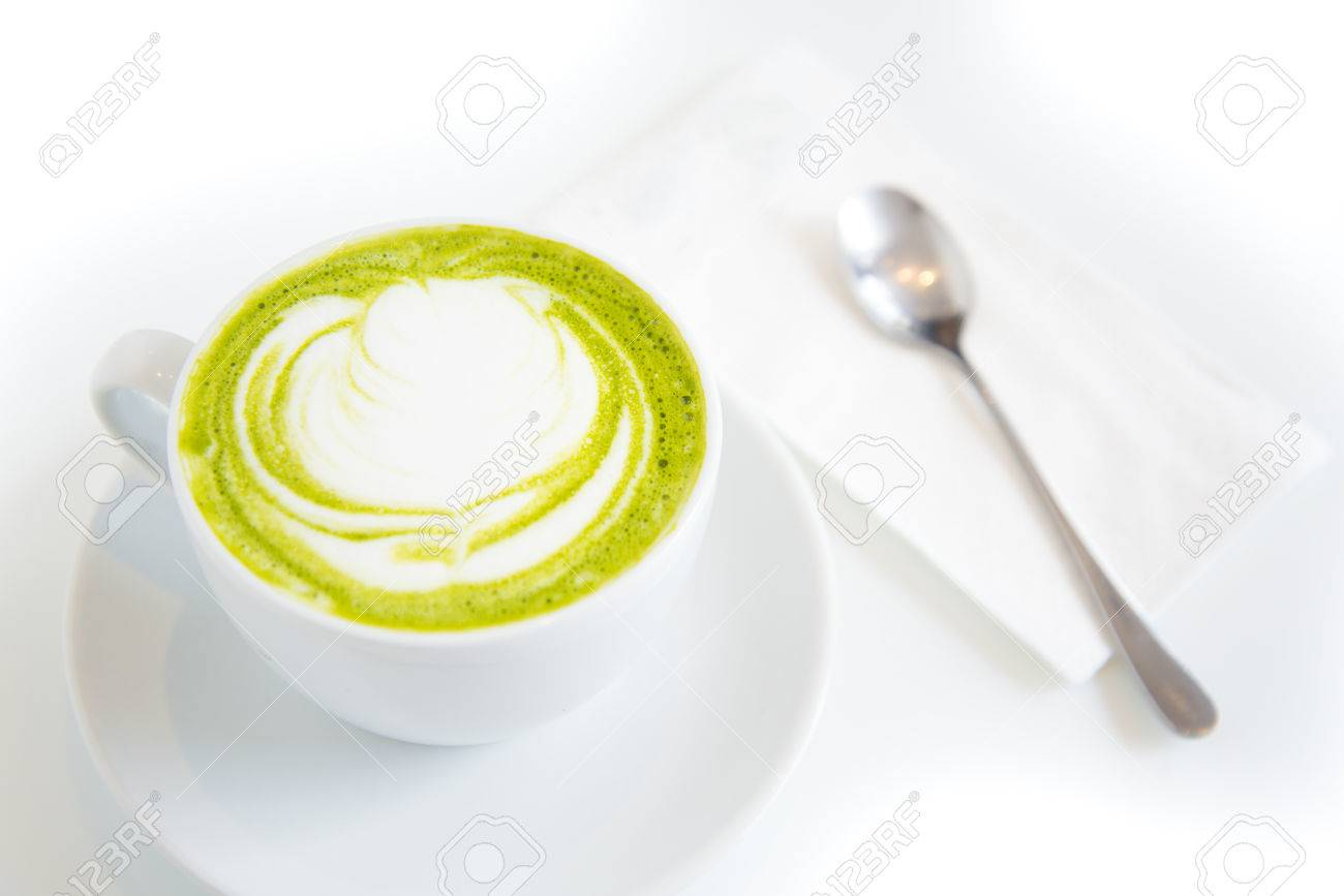 green tea latte art in white cup,isolated - 26746188