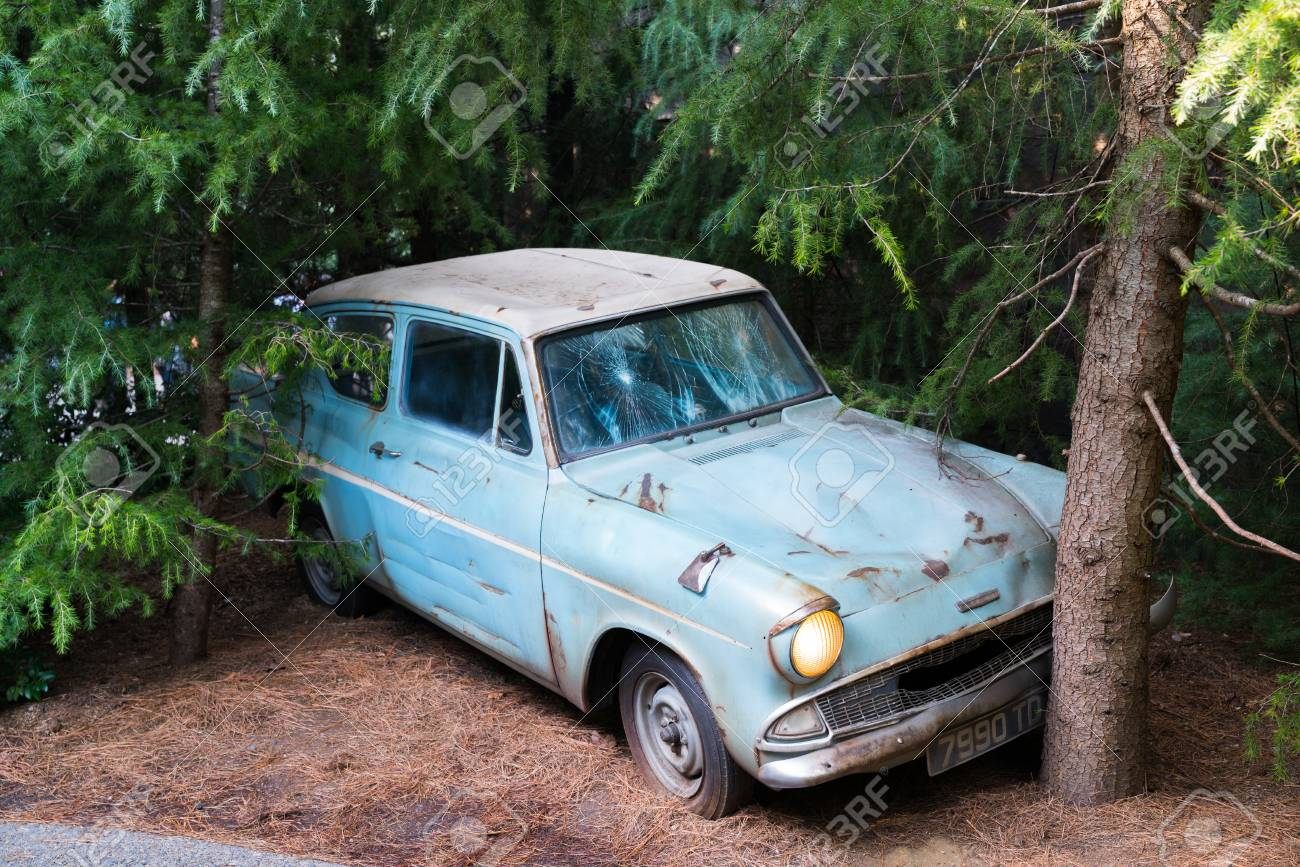 Stock photo weasley family car flying ford anglia crashed with trees in harry potter section of univeral studio japan