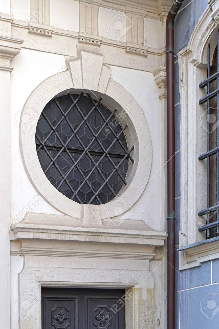 Round Window With Bars Above Door Stock Photo   54689132