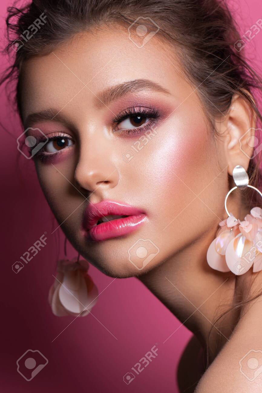 Fashion portrait of a beautiful girl with trendy pink makeup, accessories and background. Brunette model with hazel eyes - 136377533