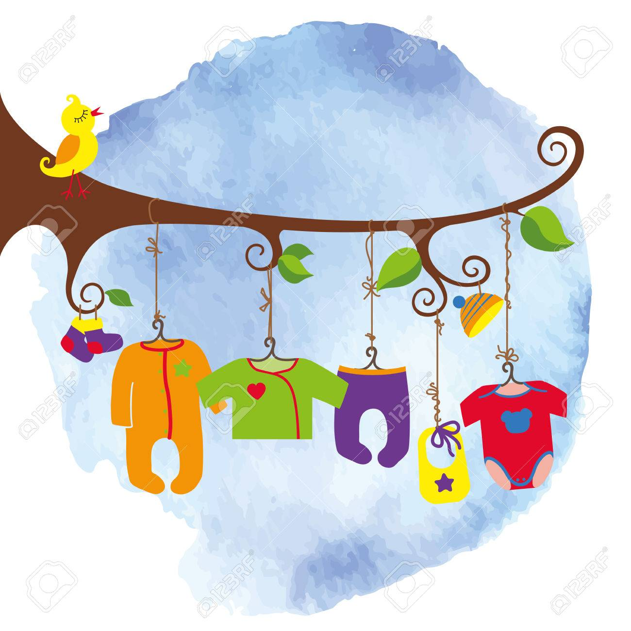 colorful newborn baby clothes hanging on rope in the tree branches