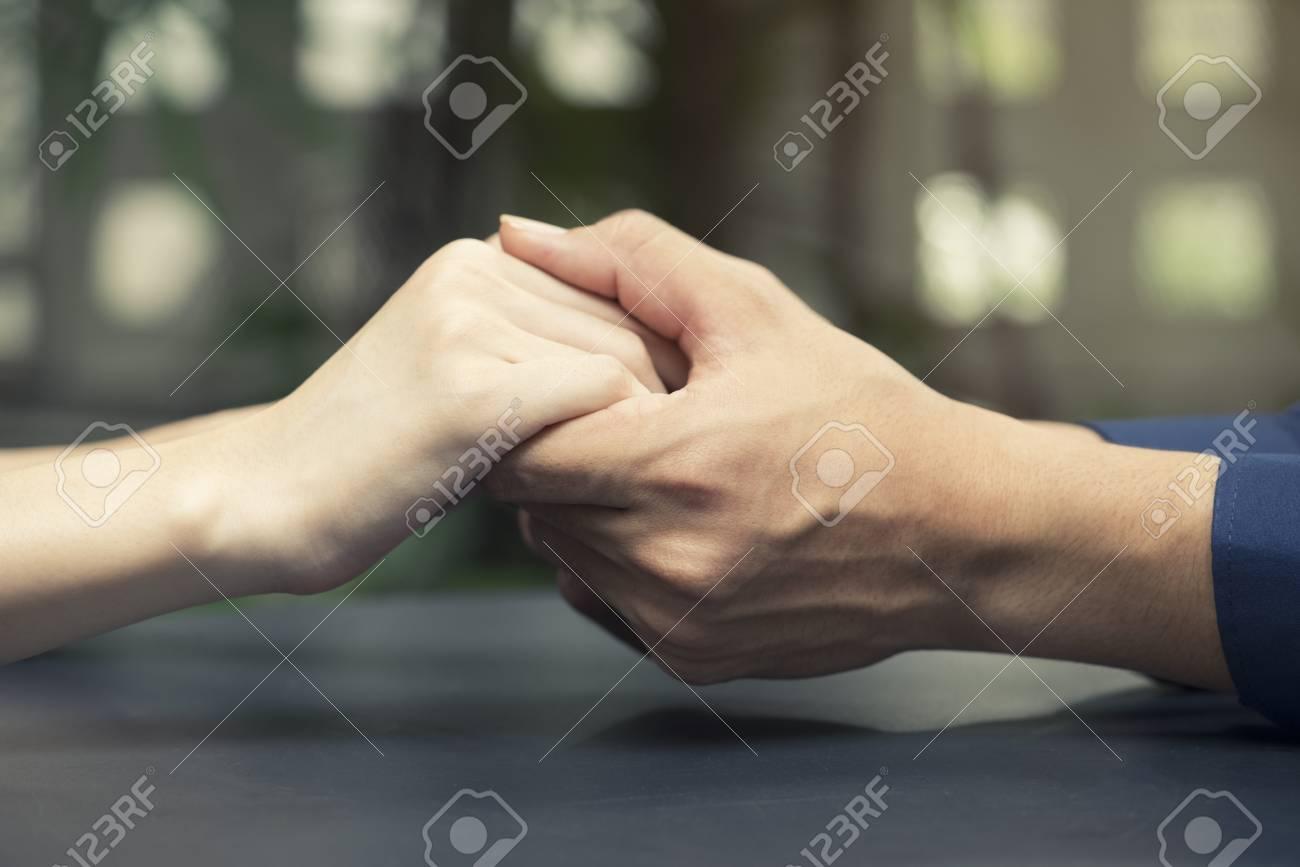 Lovers Couple Holding Hands Between Boyfriend And Girlfriend