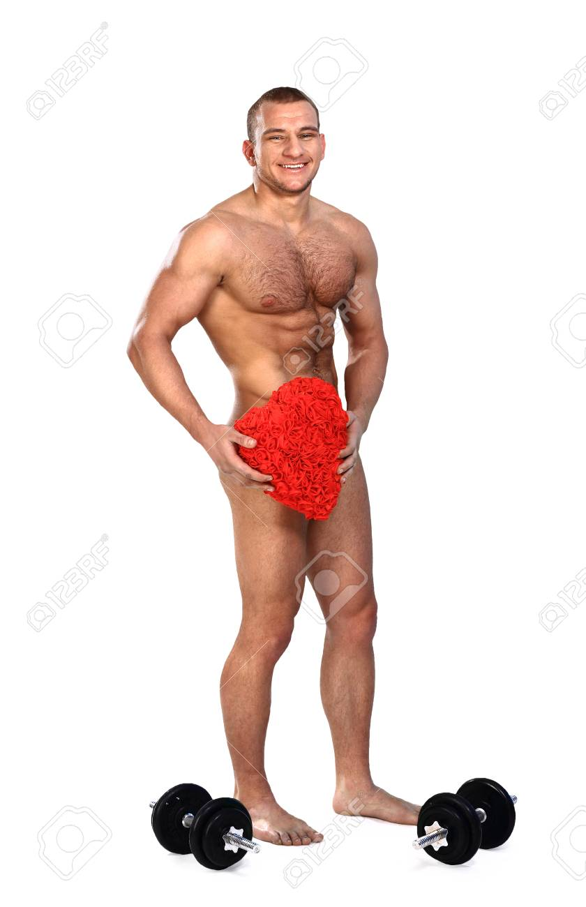 Photo of naked athlete man with strong body, with big red heart in his arms