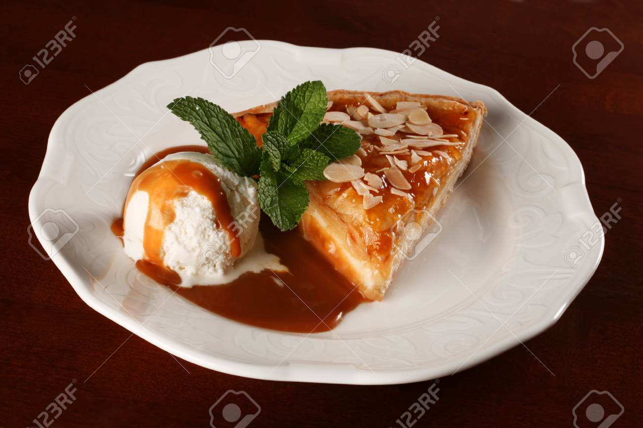Dessert with ice-cream and peppermint on white plate Stock Photo - 8651851