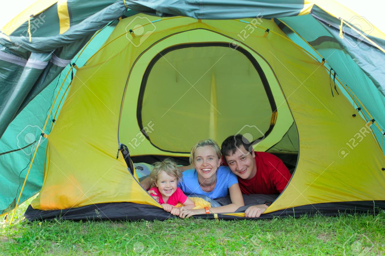 Happy family in tent on the nature Stock Photo - 9290078
