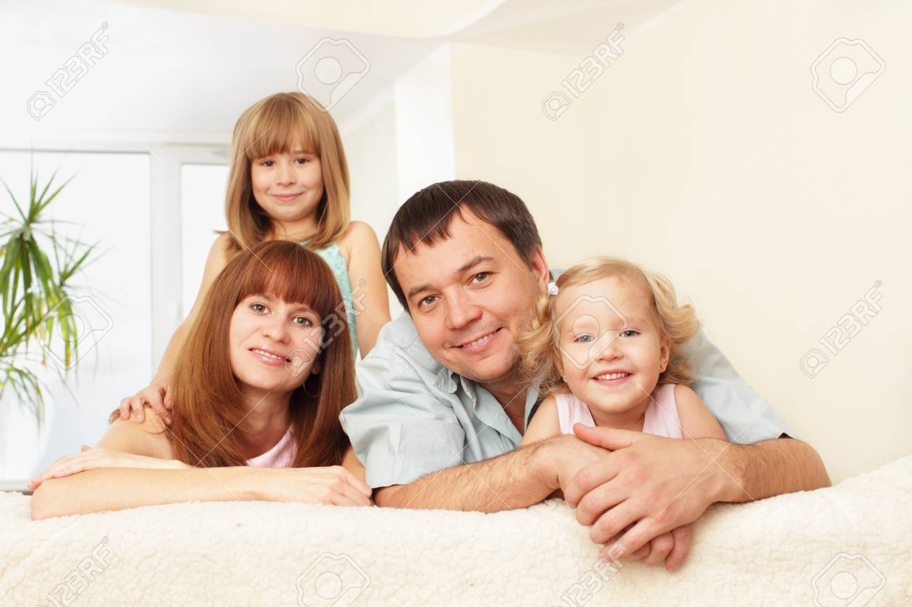 Happy family with two children on sofa Stock Photo - 9290679