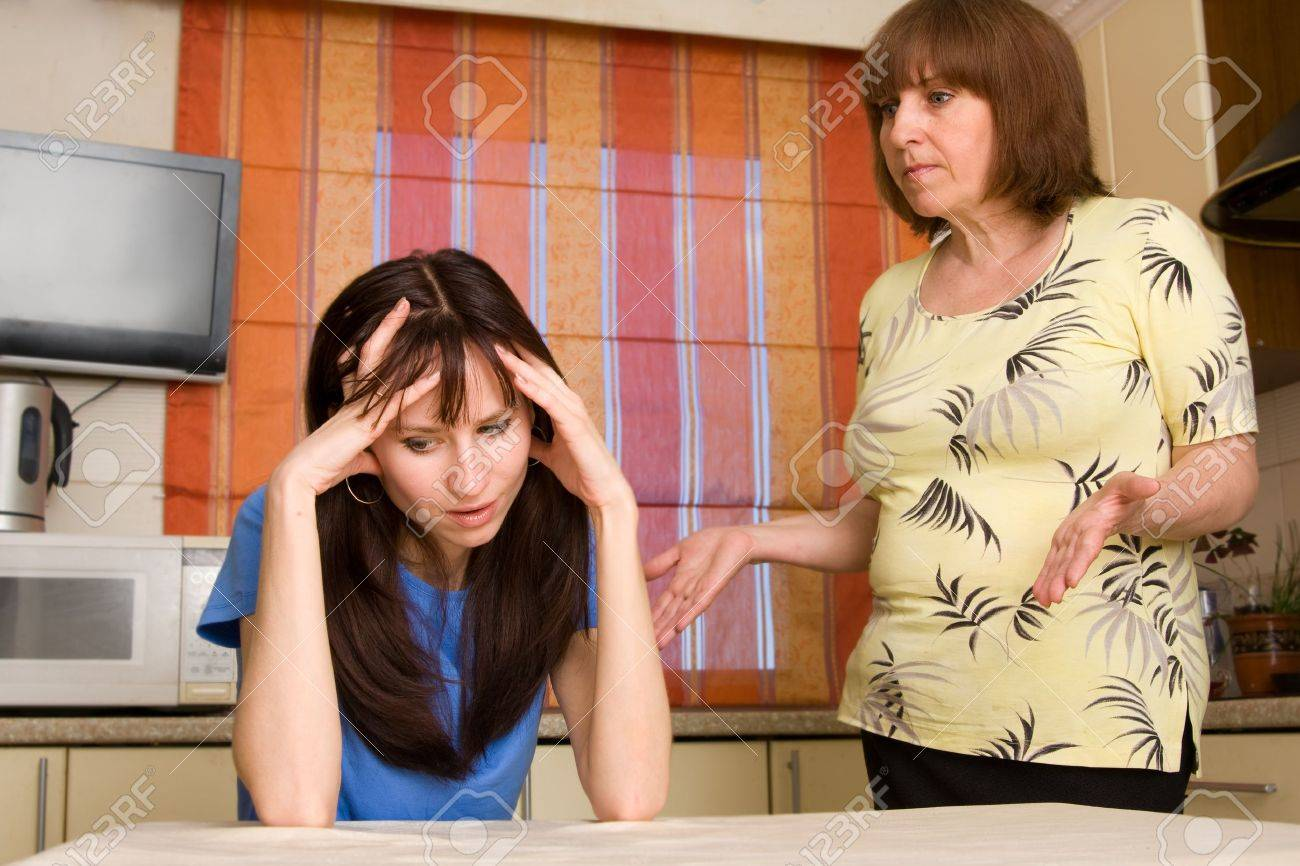 Conflict between mum and daughter at home. Search many conflicting people in my portfolio Stock Photo - 9397911
