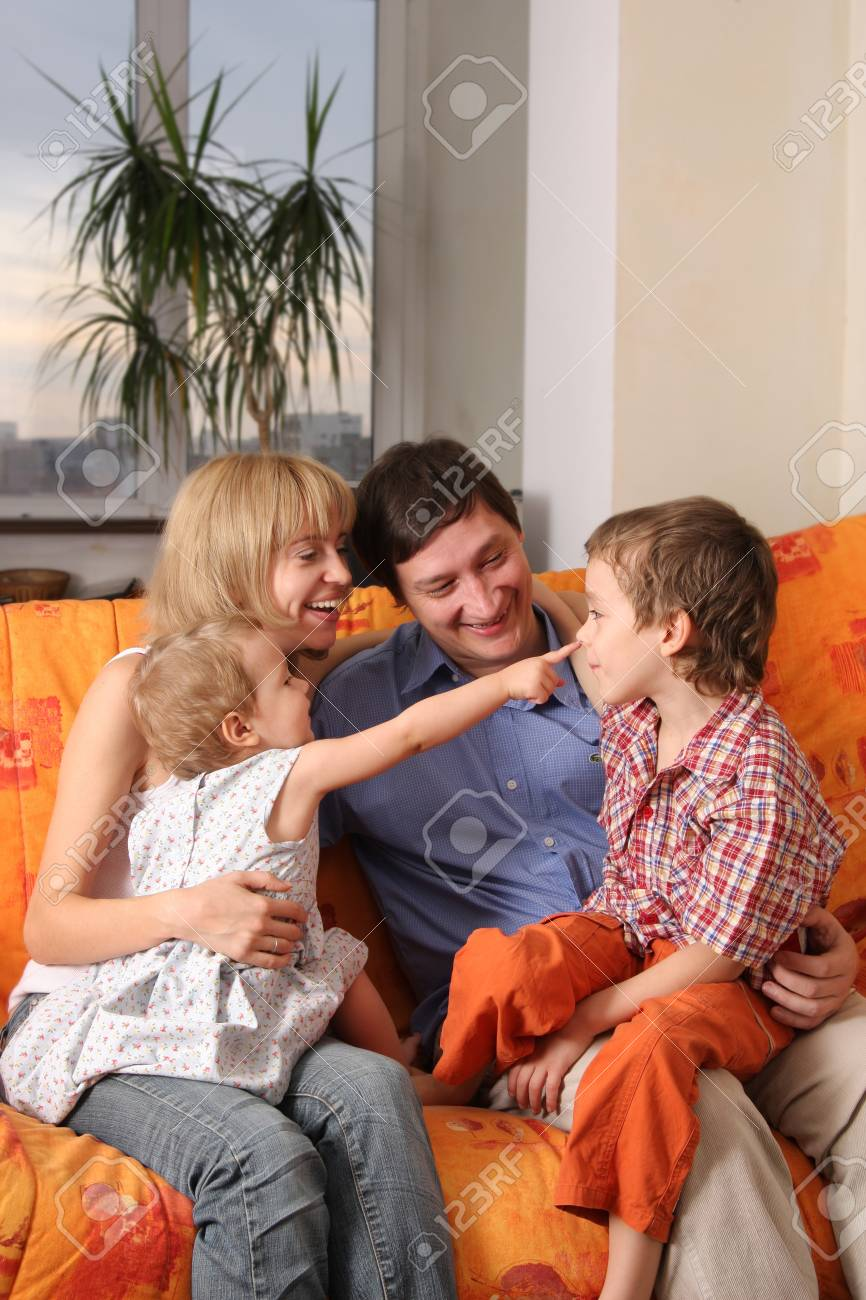 Happy family of the house on a sofa 7 Stock Photo - 9397966