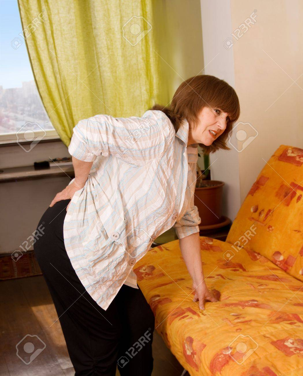 Woman keeps for a back. Pain in a back Stock Photo - 9397843