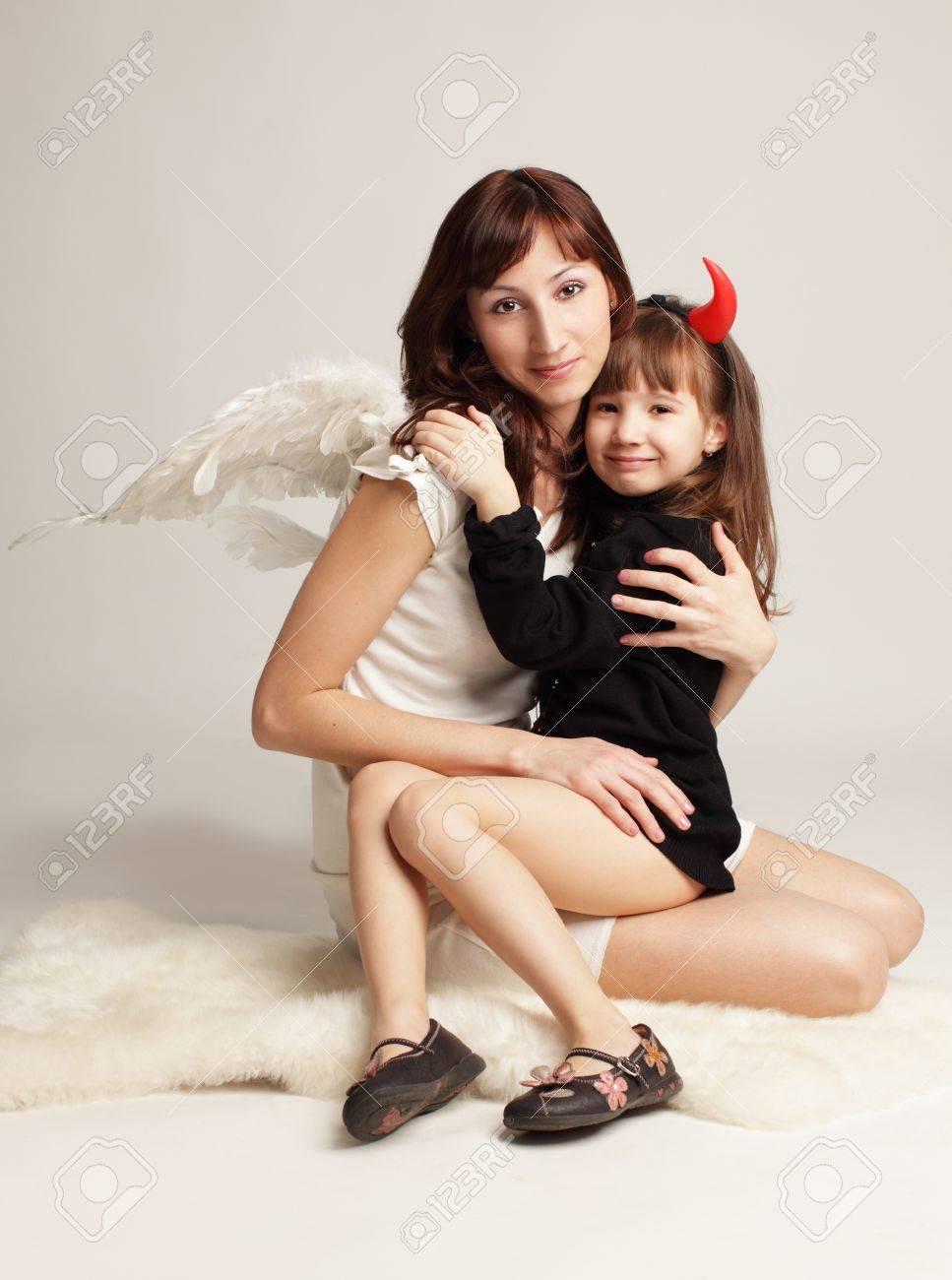 Angel y demonio poco.  Foto de archivo - 10297560