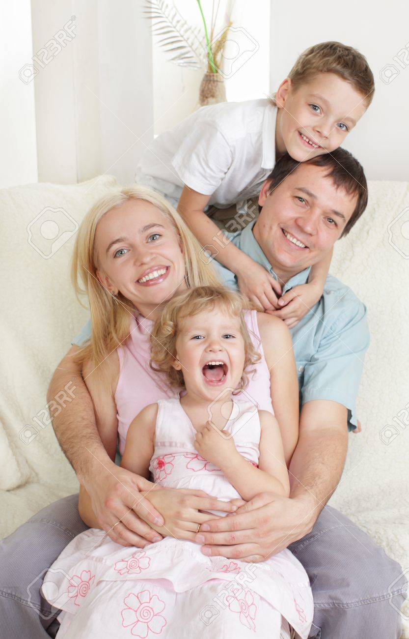 Happy family with two children on sofa Stock Photo - 10233468
