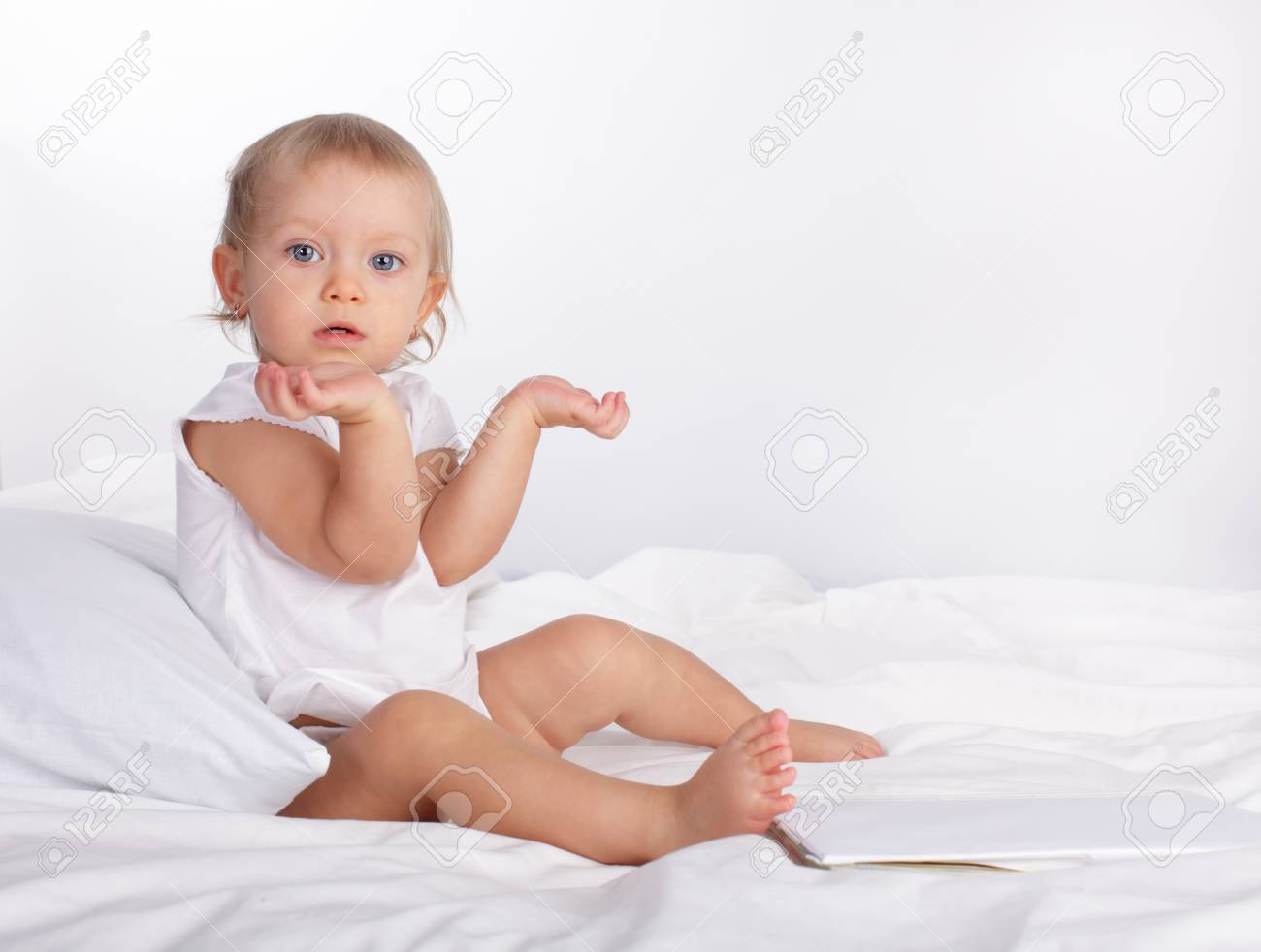 Beautiful baby in bed Stock Photo - 10233387
