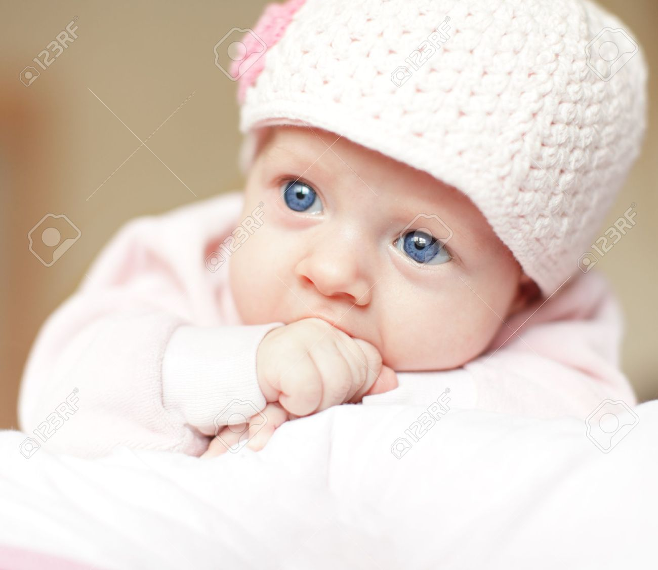 beautiful blue-eyed baby in cap stock photo, picture and royalty