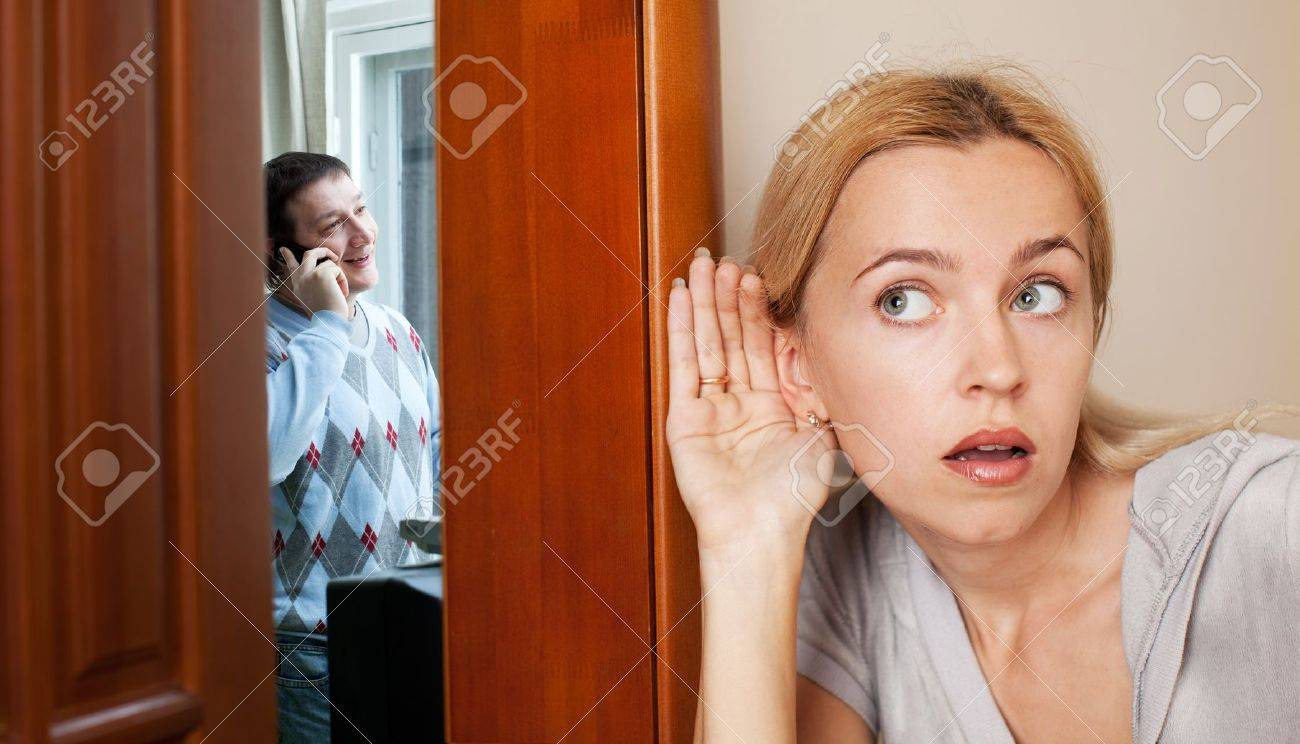 Jealous wife, overhearing a phone conversation her husband - 11530941