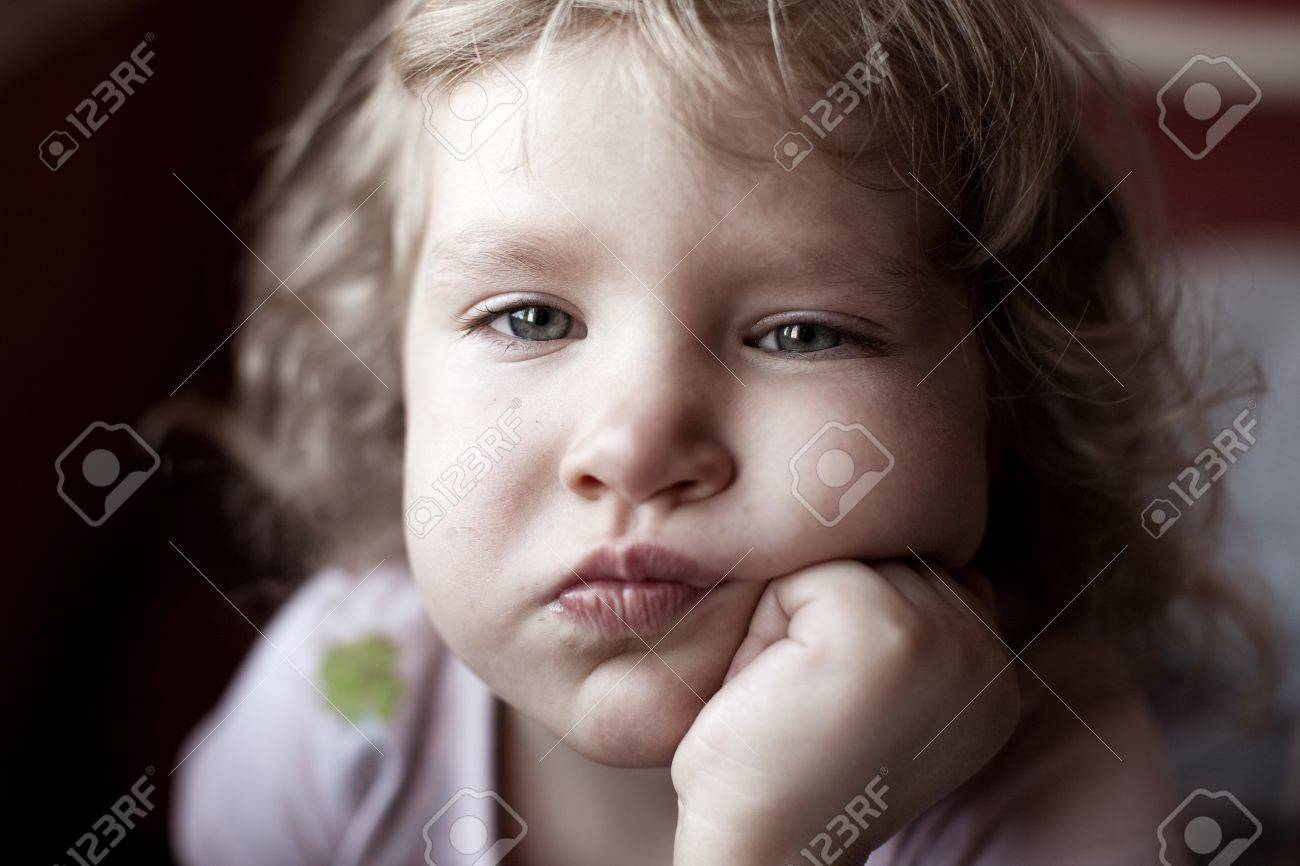 Sad little child looking at camera Stock Photo - 12466274