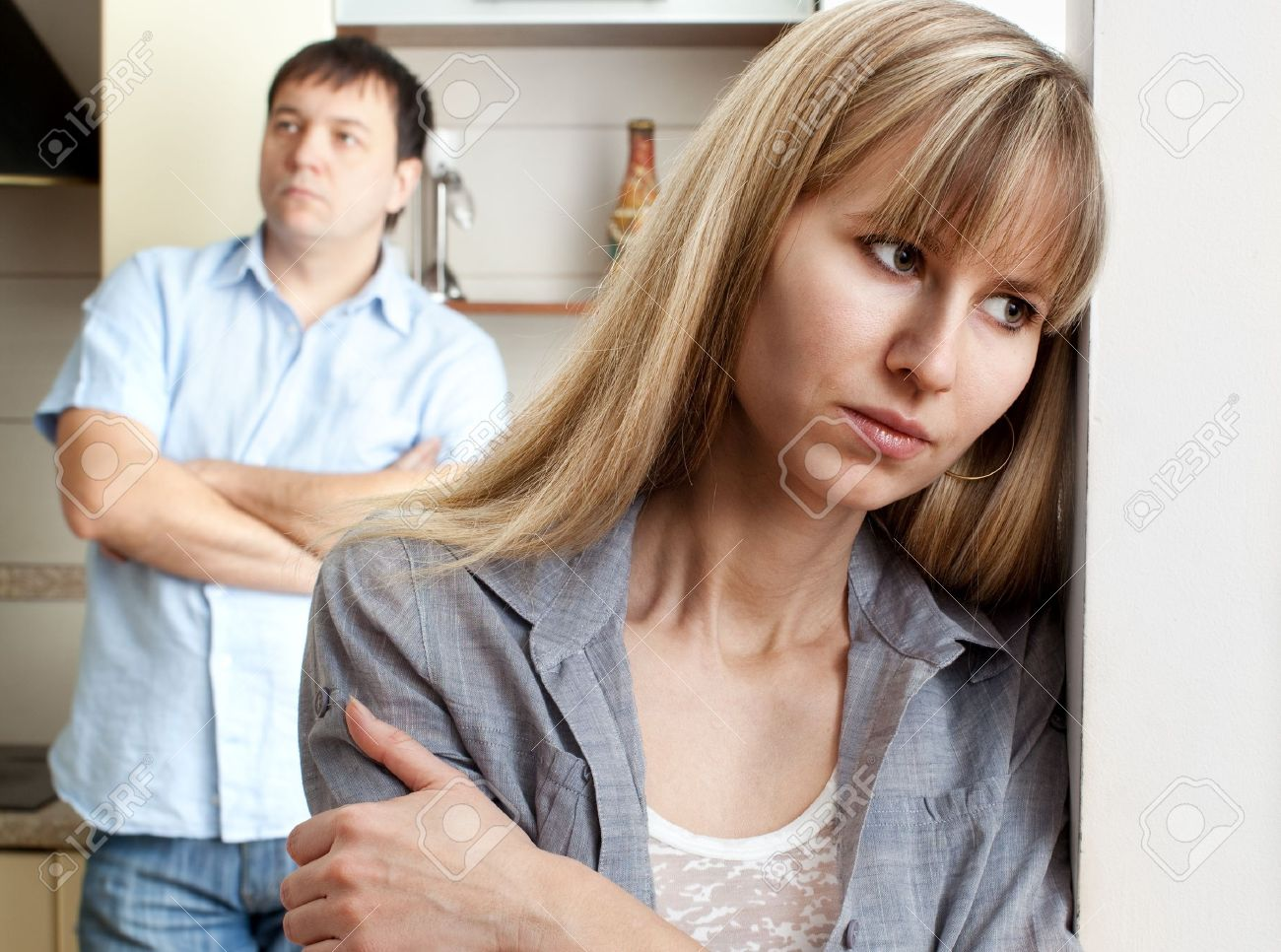 Conflict between man and woman at home - 12470591