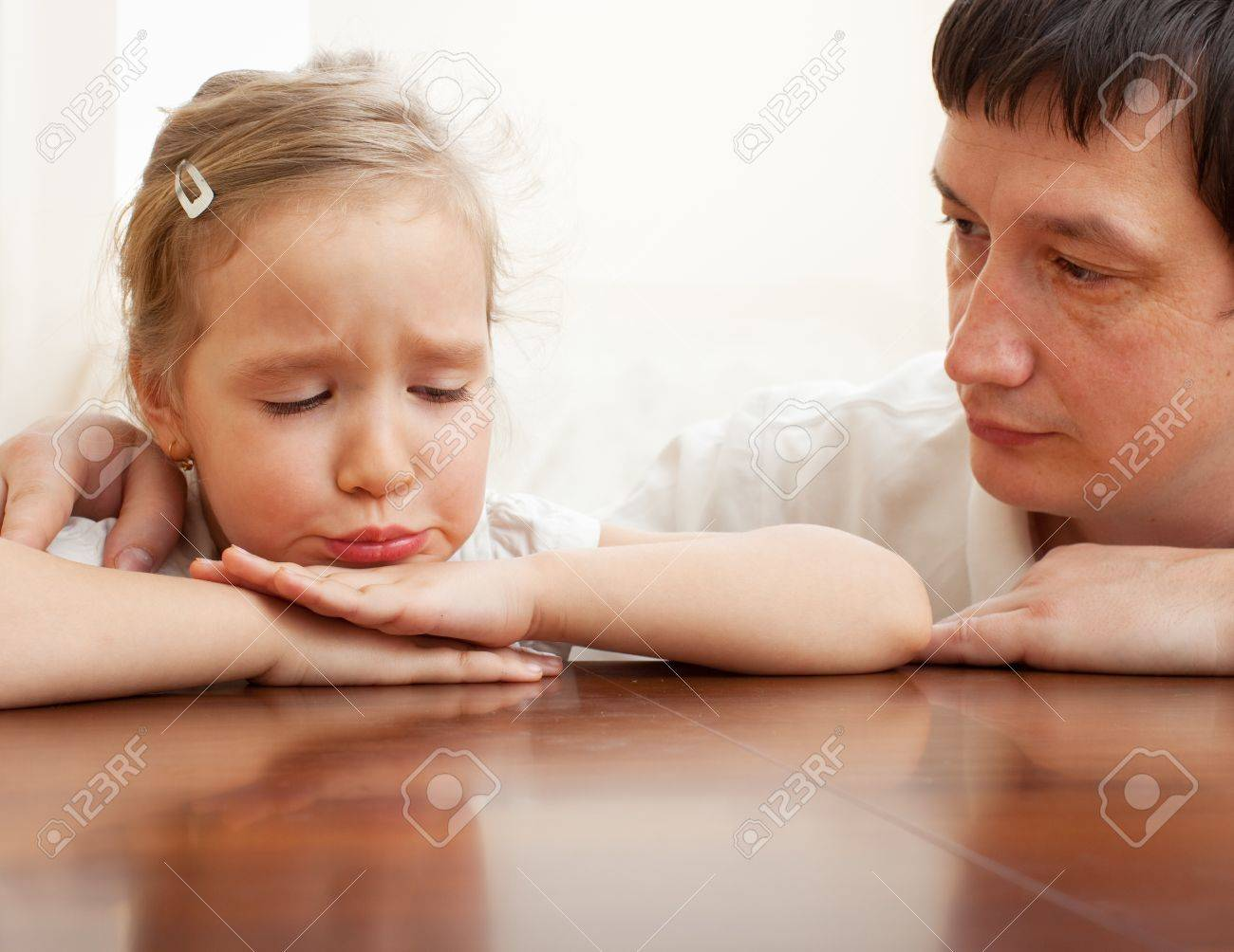 Father comforts a sad child. Problems in the family Stock Photo - 12940340