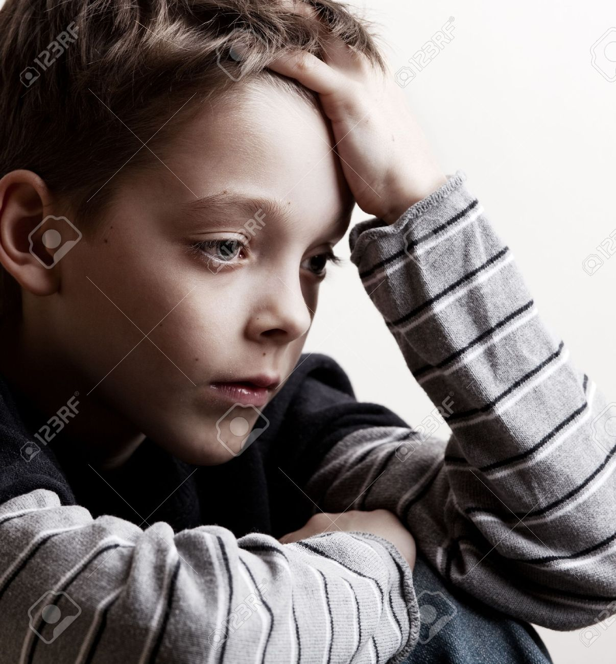 Sad boy. Depressed teenager at home. Problems at family Stock Photo - 13085459