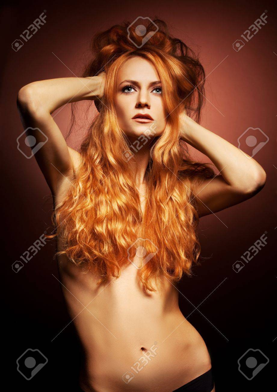Fashion portrait of redhead woman with long hair on brown background Stock Photo - 13200940
