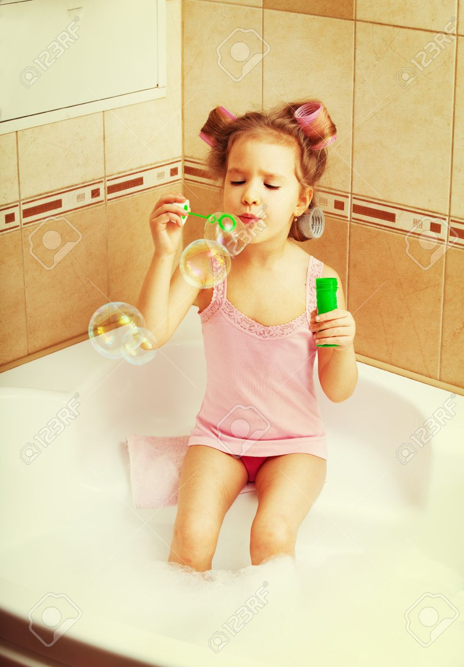 Glamour Girl Blow Bubbles In The Bathtub. Child In Bathroom Stock Photo    13272927