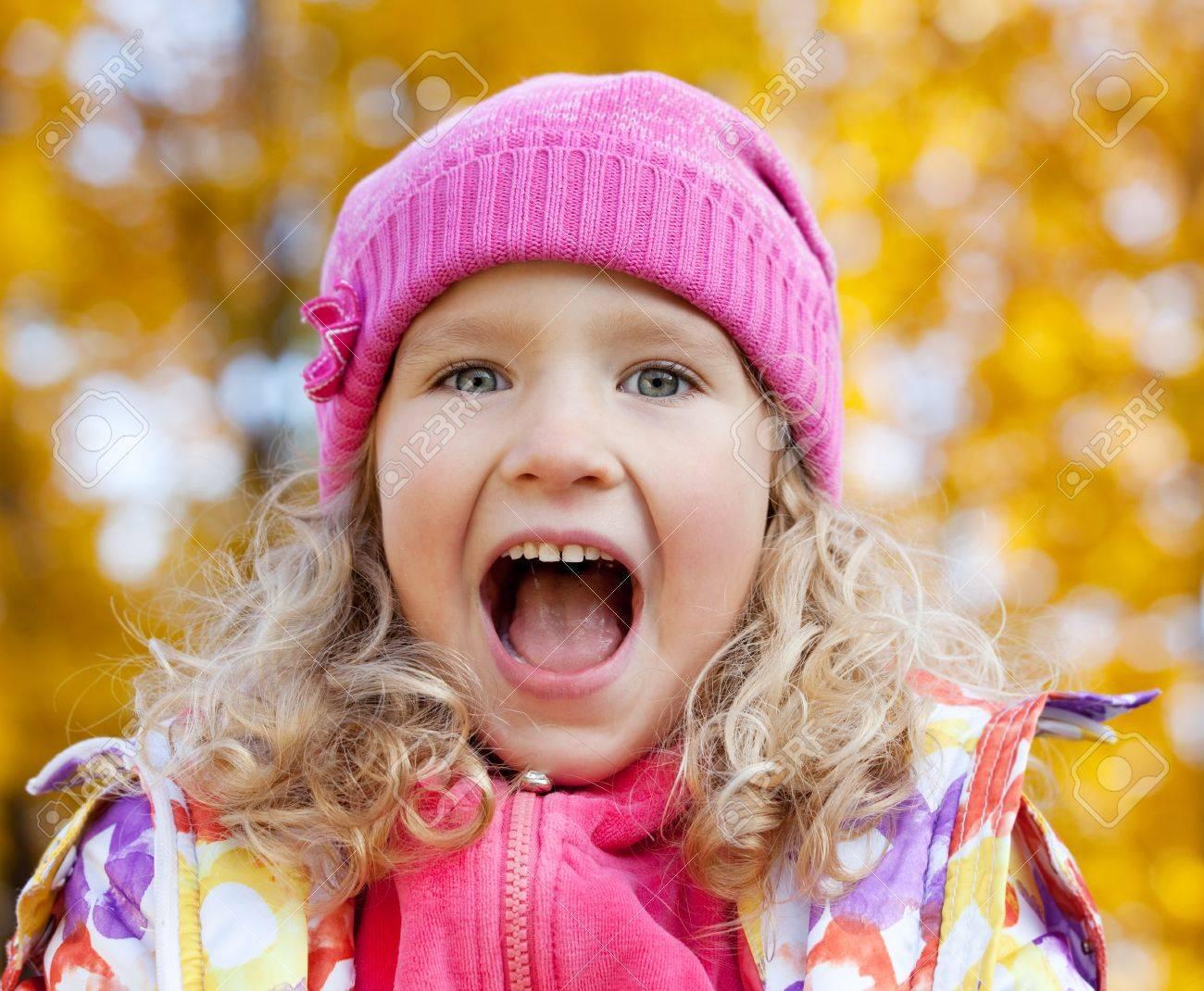 Little happy girl in autumn park Stock Photo - 13668129