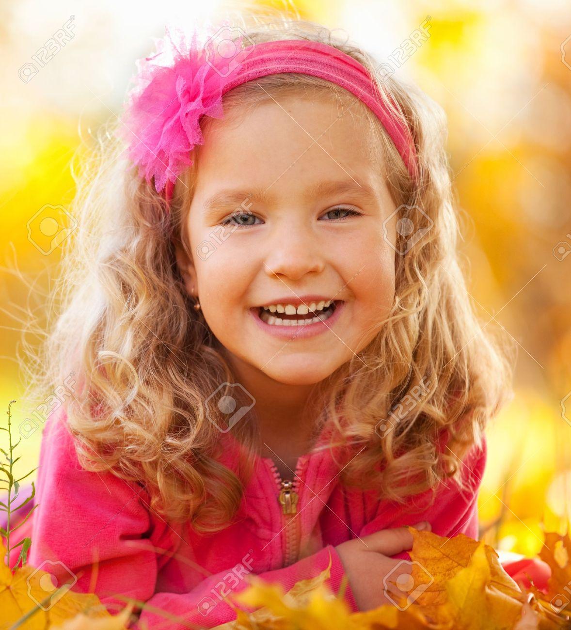 Happy little child in autumn park Stock Photo - 14491005