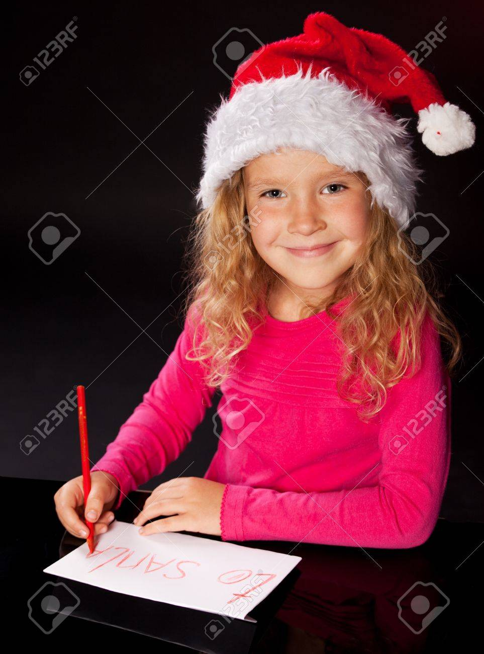 Child Writing A Letter To Santa Claus Little Girl Stock Photo