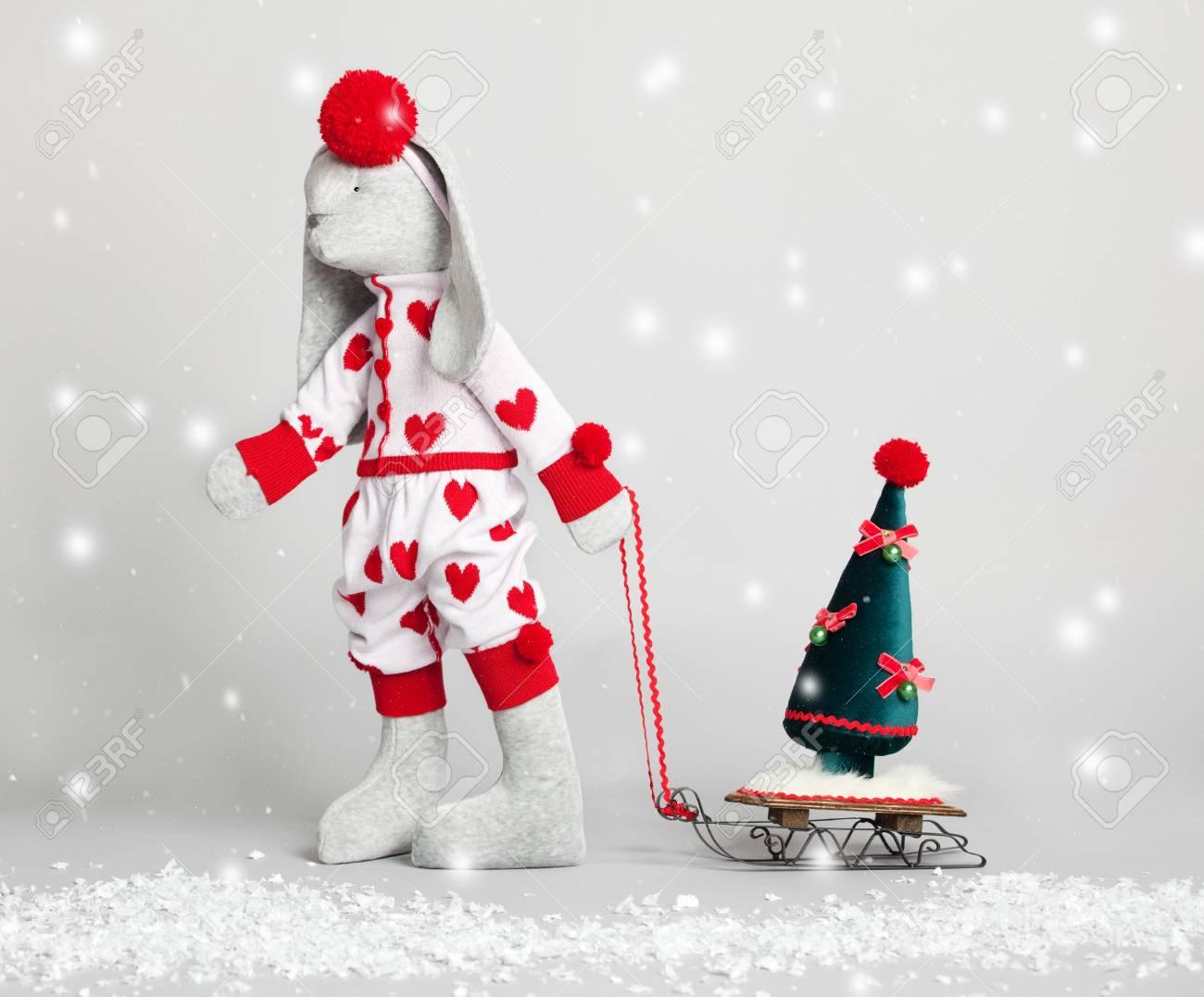 Hare dress up the tree. Christmas Card Stock Photo - 14852674